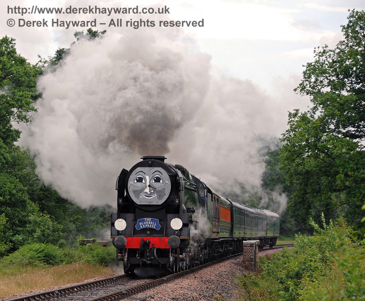34028 Eddystone looked after the Bluebell Express and blows out lots of steam on the climb past Waterworks Bridge. 23.06.2007