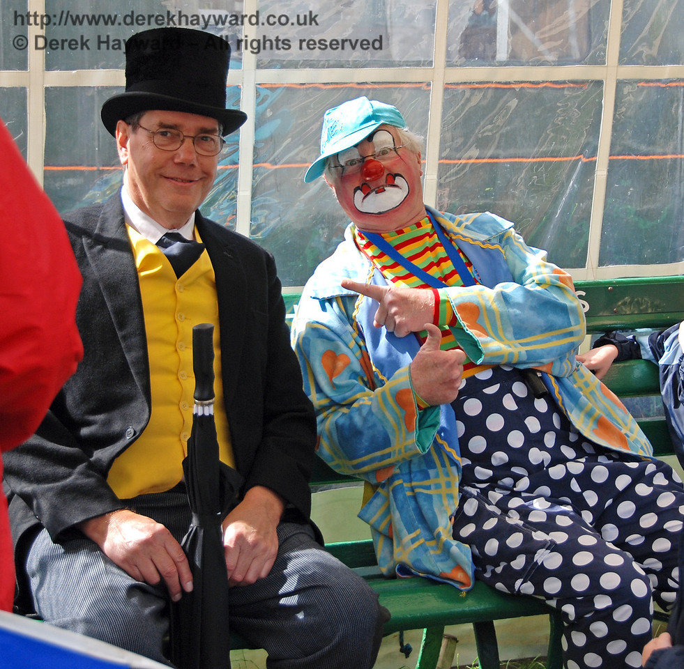 Having greeted hundreds of visitors Fat Controllers and Clowns sometimes need to sit down for a minute!! (Beware of passing photographers). Horsted Keynes 01.07.2007