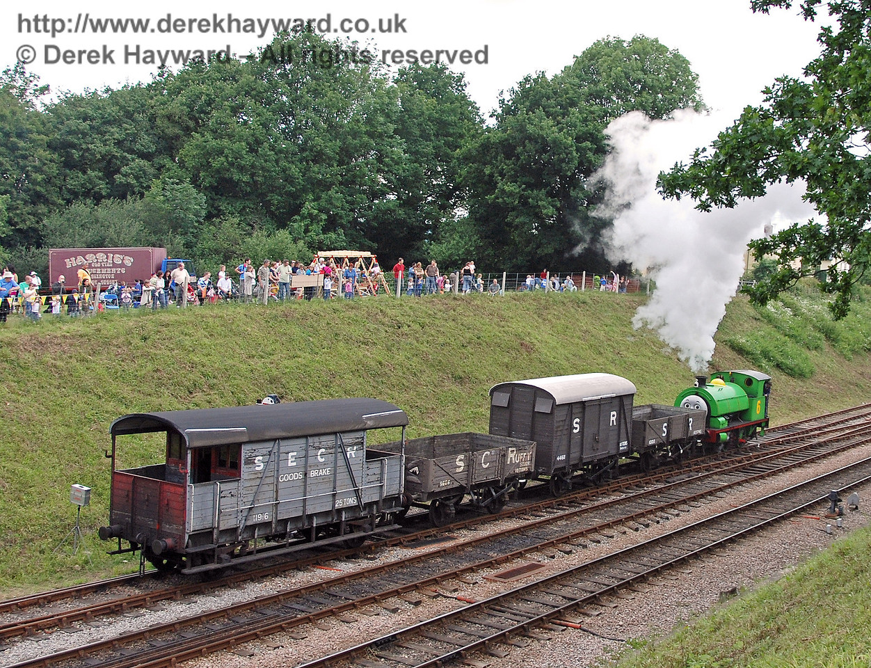 The crowd watches as Percy takes the Troublesome Trucks along the siding. Horsted Keynes 23.06.2007