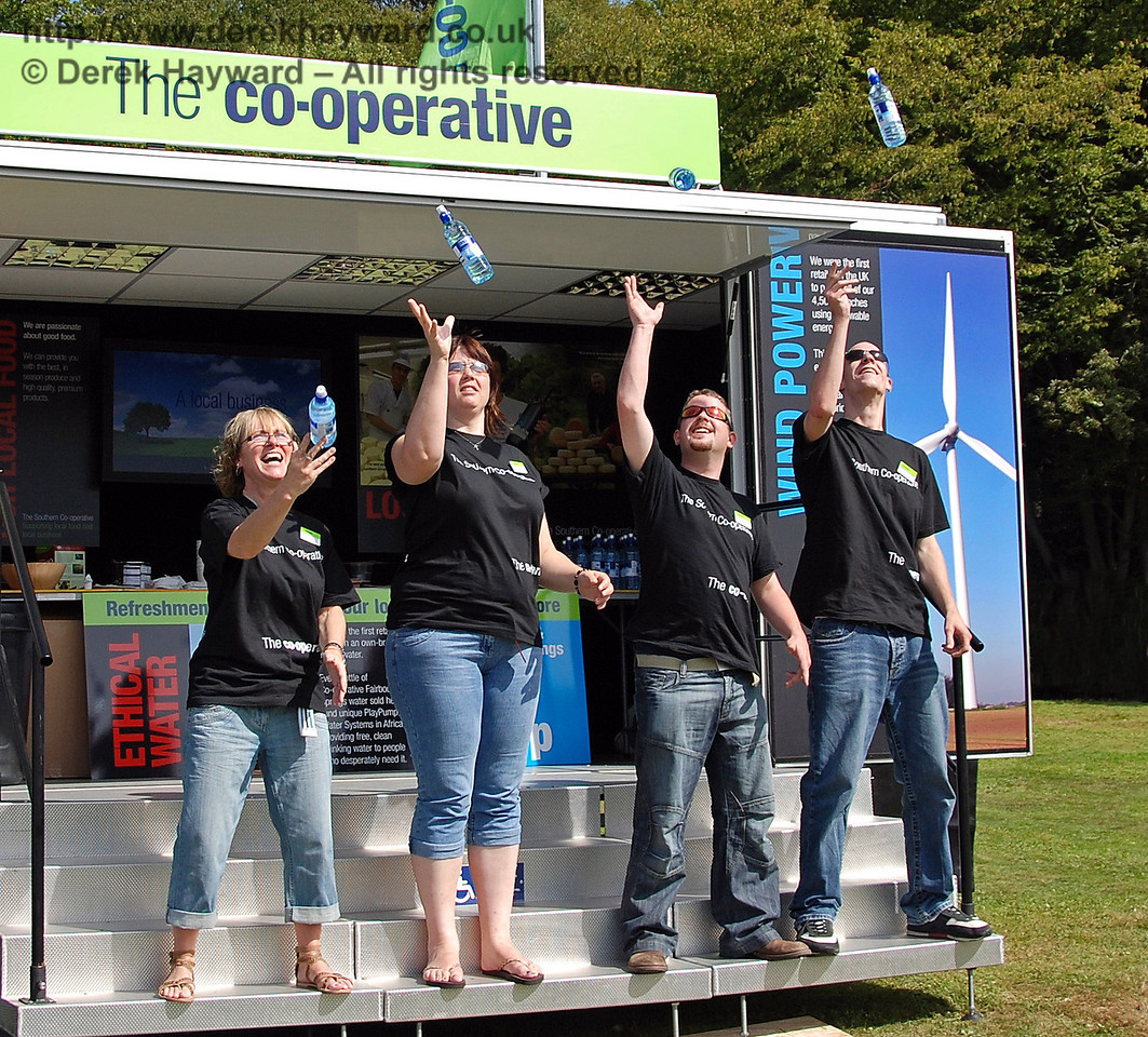 For some reason the staff of the Co-op were throwing bottles of water into the air.... Horsted Keynes 23.08.2009