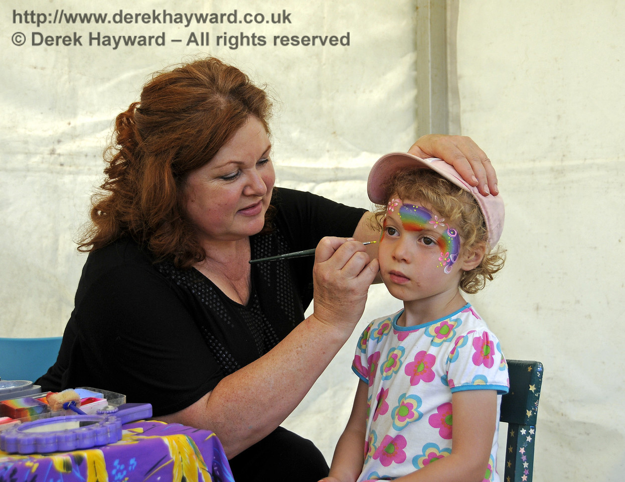 You have to keep very still and concentrate very hard when Zoe is painting your face.  Sussex Food Festival, Horsted Keynes, 06.07.2013  9472