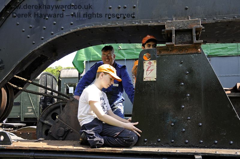 Members of the 9F Club working (under supervision) on the cosmetic refurbishment of the Ransomes and Rapier Ltd Steam Crane.  Horsted Keynes 18.05.2014  10554