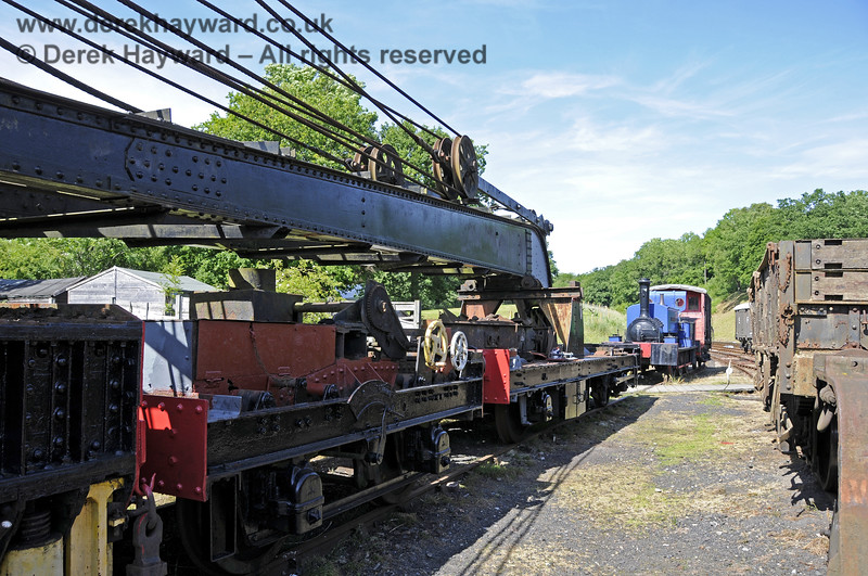 Taken in rather restricted space, the Ransomes and Rapier Ltd Steam Crane, with some refurbishment and repainting having taken place.   Horsted Keynes  30.06.2013  9368