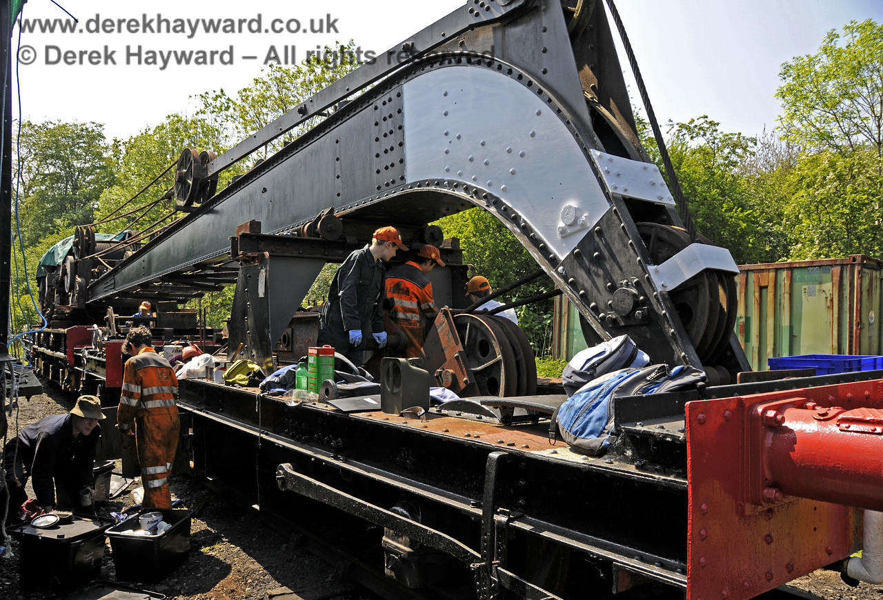 Members of the 9F Club working (under supervision) on the cosmetic refurbishment of the Ransomes and Rapier Ltd Steam Crane.  Horsted Keynes 18.05.2014  10550