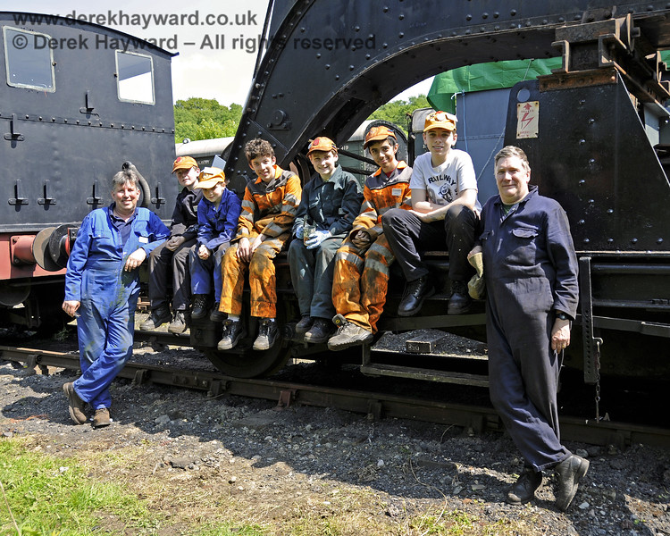 Members of the 9F Club working (under supervision) on the cosmetic refurbishment of the Ransomes and Rapier Ltd Steam Crane.  Horsted Keynes 18.05.2014  10561