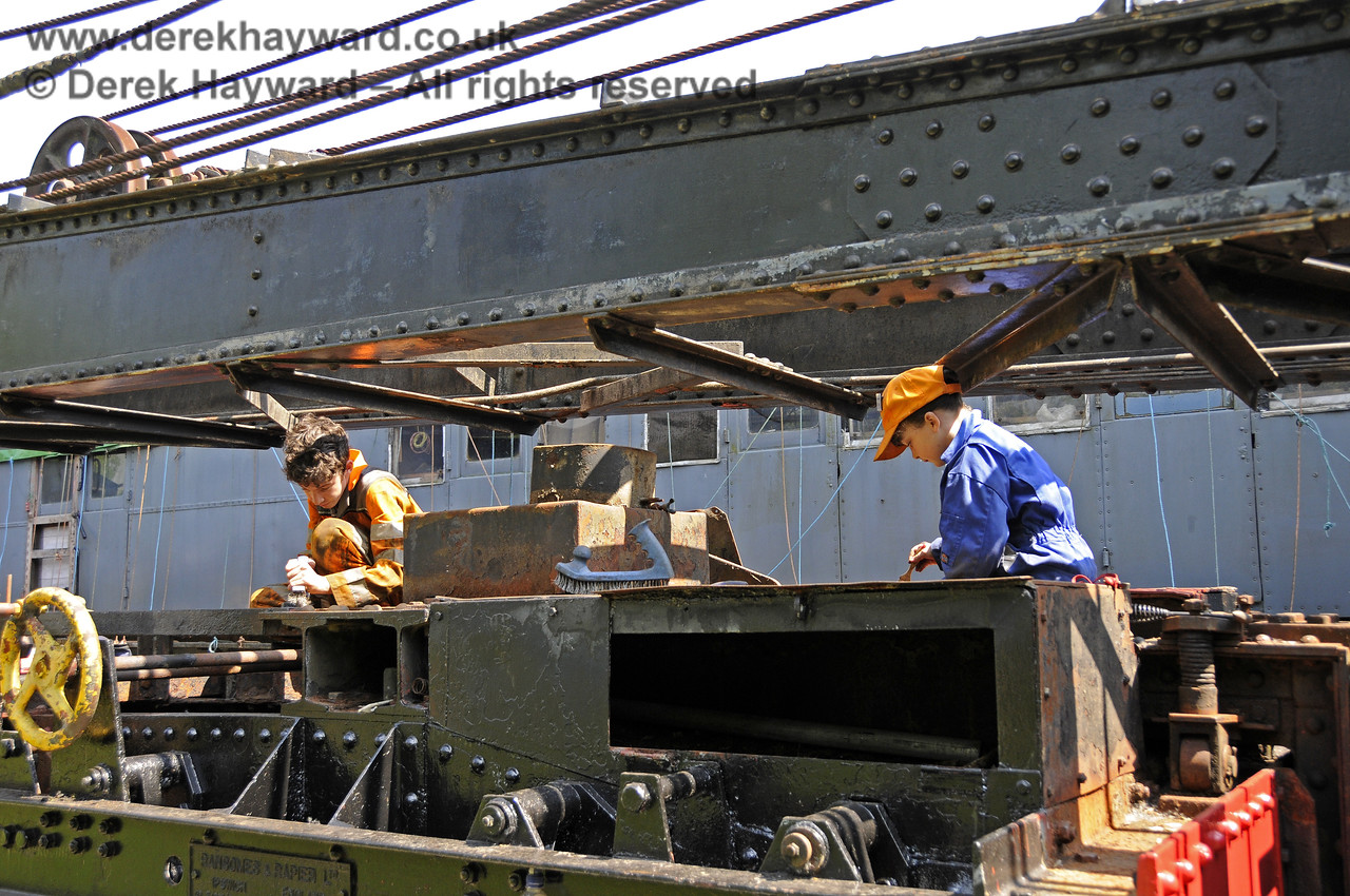 Members of the 9F Club working (under supervision) on the cosmetic refurbishment of the Ransomes and Rapier Ltd Steam Crane.  Horsted Keynes 18.05.2014  10556
