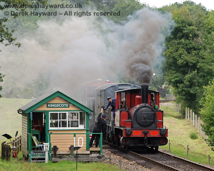 Captain Baxter receives the single line token from the signalman at Kingscote. 15.08.2010 30041