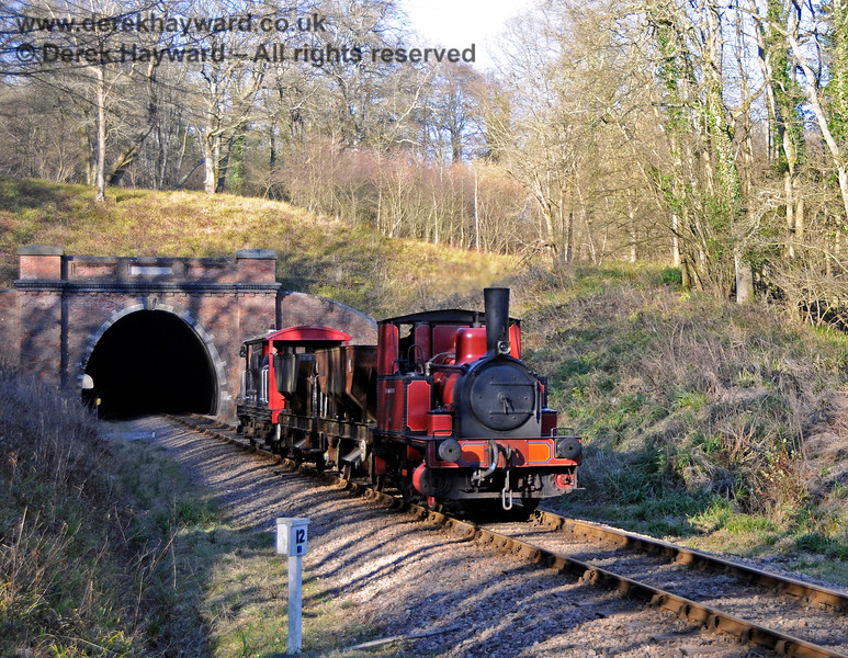 Captain Baxter emerges from the south portal of West Hoathly Tunnel. 07.03.2015 12032