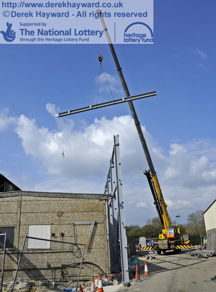Lifting and moving the main beam for the southern end of the Workshops into position (a series of pictures).  03.04.2012  4219