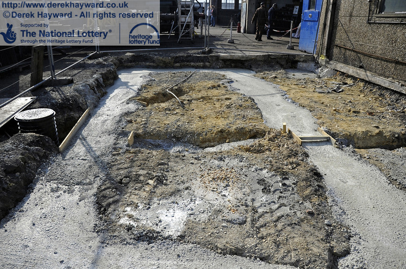 Concrete has now been poured in the foundations outside the entrance to the Workshops.  25.03.2012  4121