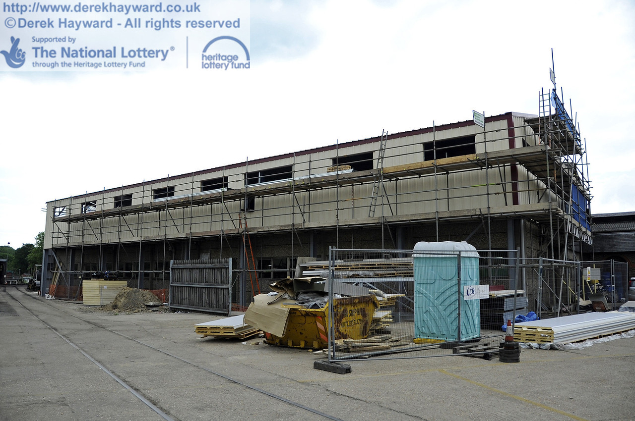 Looking west towards the building with the installation of cladding and windows in progress.  30.05.2012  4936
