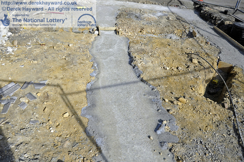 Concrete has now been poured in the foundations outside the entrance to the Workshops.  25.03.2012  4117