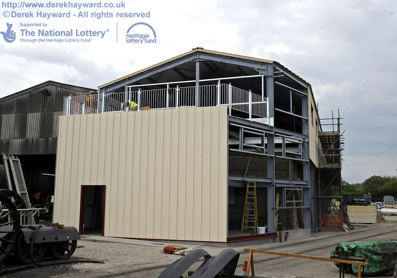 Looking north towards the building with the installation of cladding and windows in progress.  30.05.2012  4944