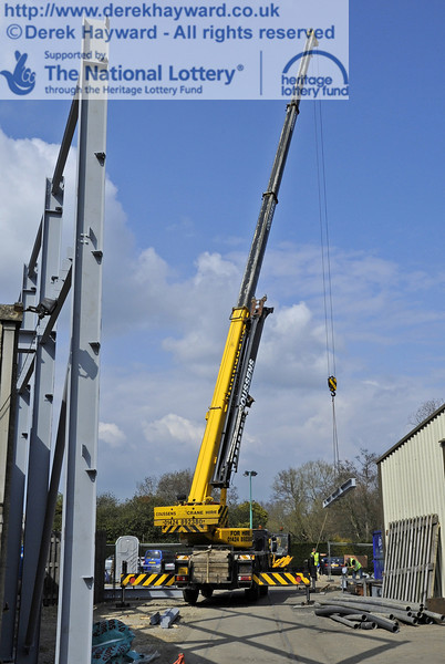 Lifting and moving the main beam for the southern end of the Workshops into position (a series of pictures).  03.04.2012  4212