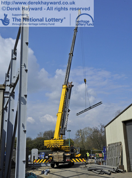 Lifting and moving the main beam for the southern end of the Workshops into position (a series of pictures).  03.04.2012  4214