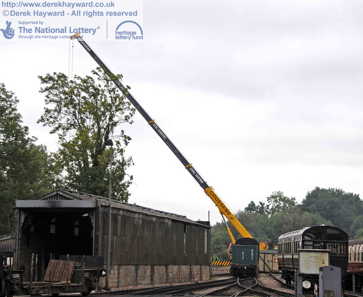 A number of containers and van bodies needed to be moved from a position east of the original locomotive shed, to an area of prepared ground adjacent to the south end of the line. The crane dominates the area. 10.09.2010  4724