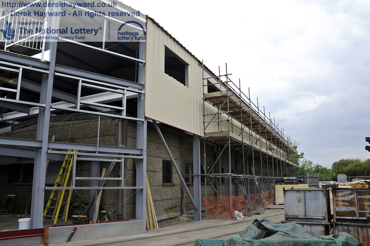Looking along the eastern side of the building with the installation of cladding and windows in progress.  30.05.2012  4946
