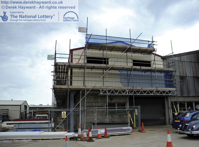 Looking south towards the building with the installation of cladding and windows in progress.  30.05.2012  4937