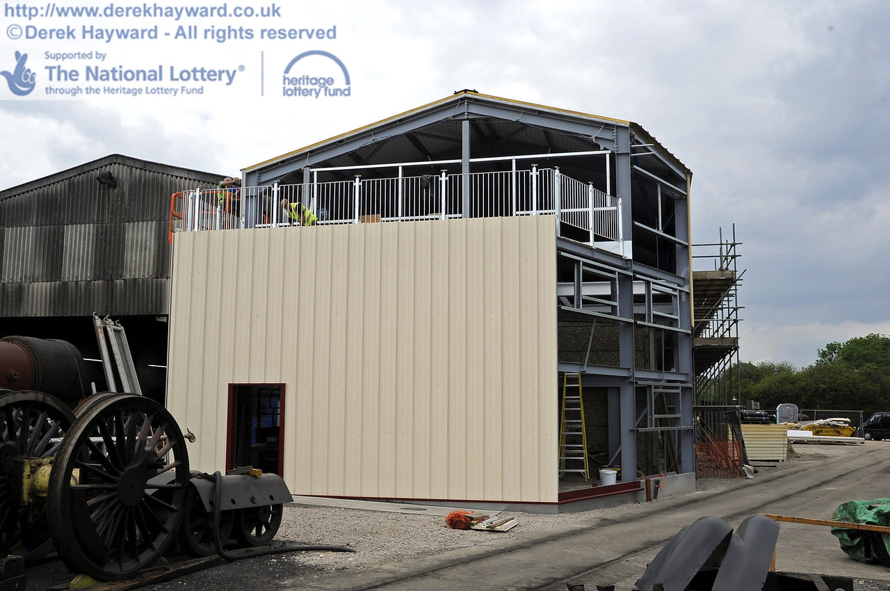 Looking north towards the building with the installation of cladding and windows in progress.  30.05.2012  4943