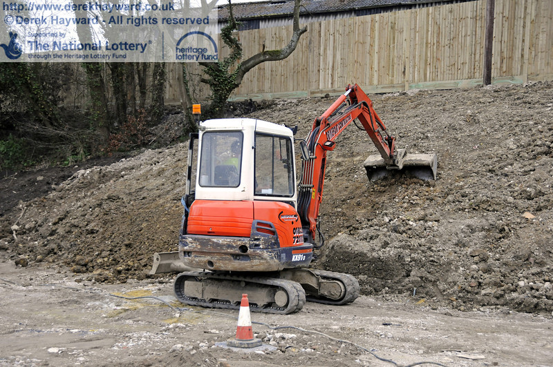 Putting the finishing touches to the reshaped eastern embankment.  17.03.2011  6517