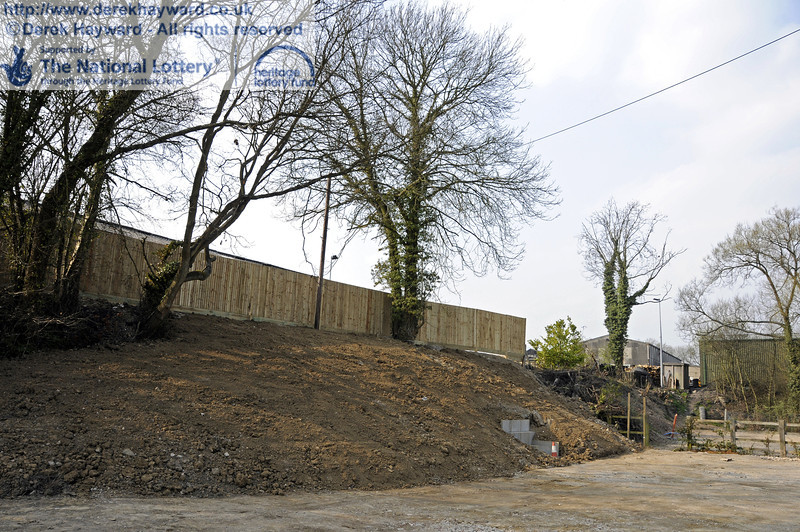 Looking west at the reshaped eastern embankment.  The wash out pit is behind the new fence.  25.03.2011  6575