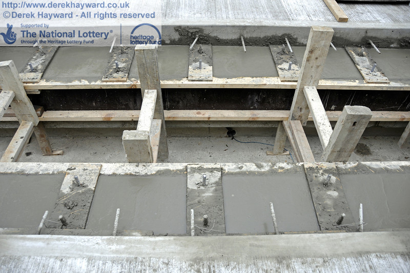 A close up of the temporary shuttering in the pit.  Plates and bolts to receive the track are in place.  17.03.2011  6373