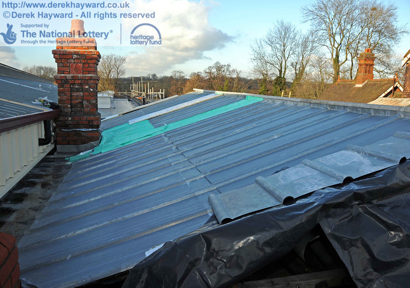 Looking north along the new zinc roof on the rear of the existing canopy. Owing to the age of the canopy some of the timbers are no longer straight and true, and standard zinc sheets could not be fitted with certainty of a waterproof seal. Some sheets are therefore being modified to fit, and the patches will then be removed. 18.01.2011  5585