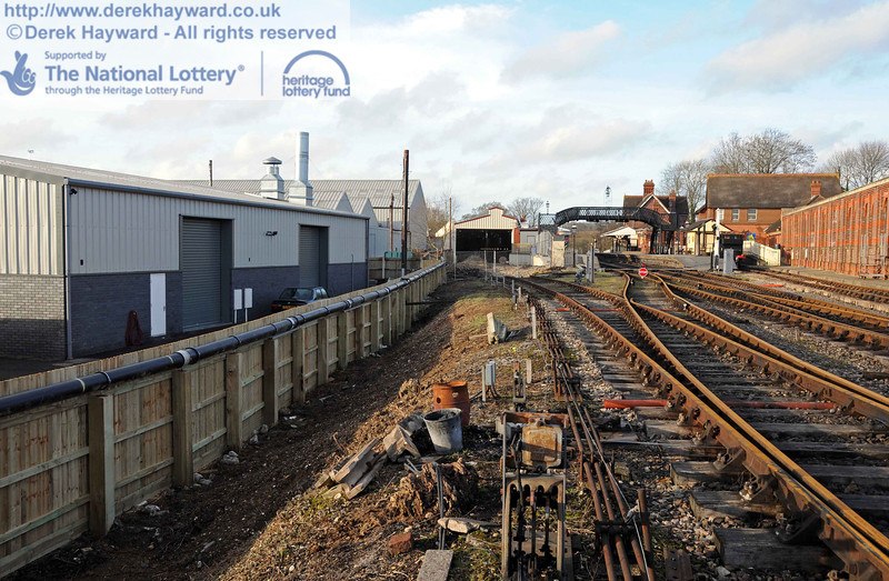Looking north towards the carriage shed with the new fence and pipe on the left. 03.02.2011  5731