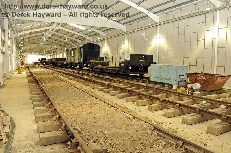 Looking south along the length of the Carriage Shed from the buffers.  The first batch of fill material has been laid between the sleepers in C road.  13.08.2011  2465