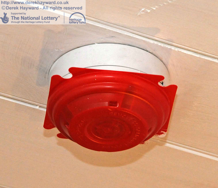 A fire detector, with dust cover in place during the works. 18.01.2011  5564
