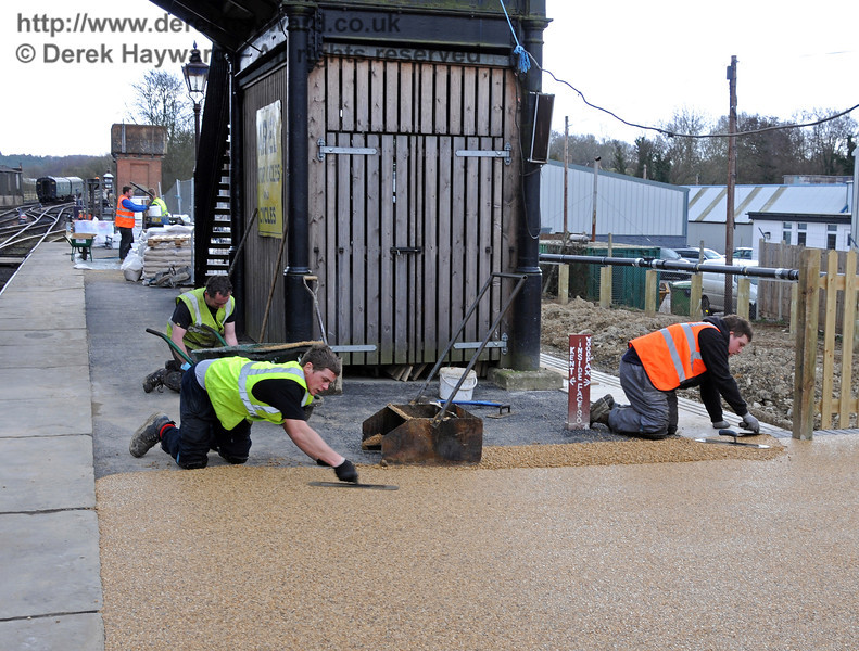 Laying the new stone resin surface on Platform 2 at Sheffield Park.  09.03.2011  6111