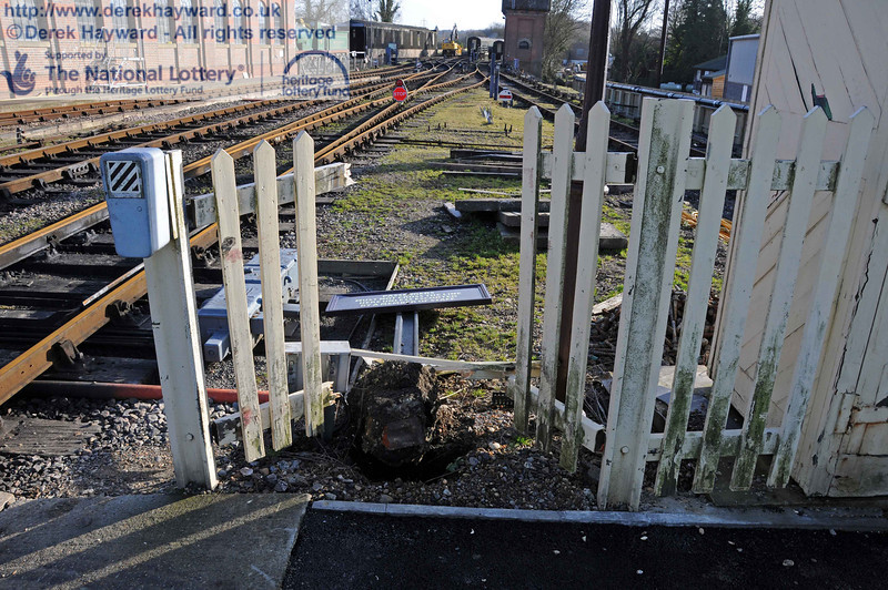 Someone will receive three penalty points for driving without due care and attention. Something has gone through the fence at the southern end of Platform 2 with sufficient force to take out a rail mounted sign in a large lump of concrete (not to mention the fence). Having conducted an extensive forensic investigation I can say it was red and almost certainly had rubber wheels or tracks. The contractors deny all knowledge. It missed the signal cables by a fraction. 03.02.2011  5716