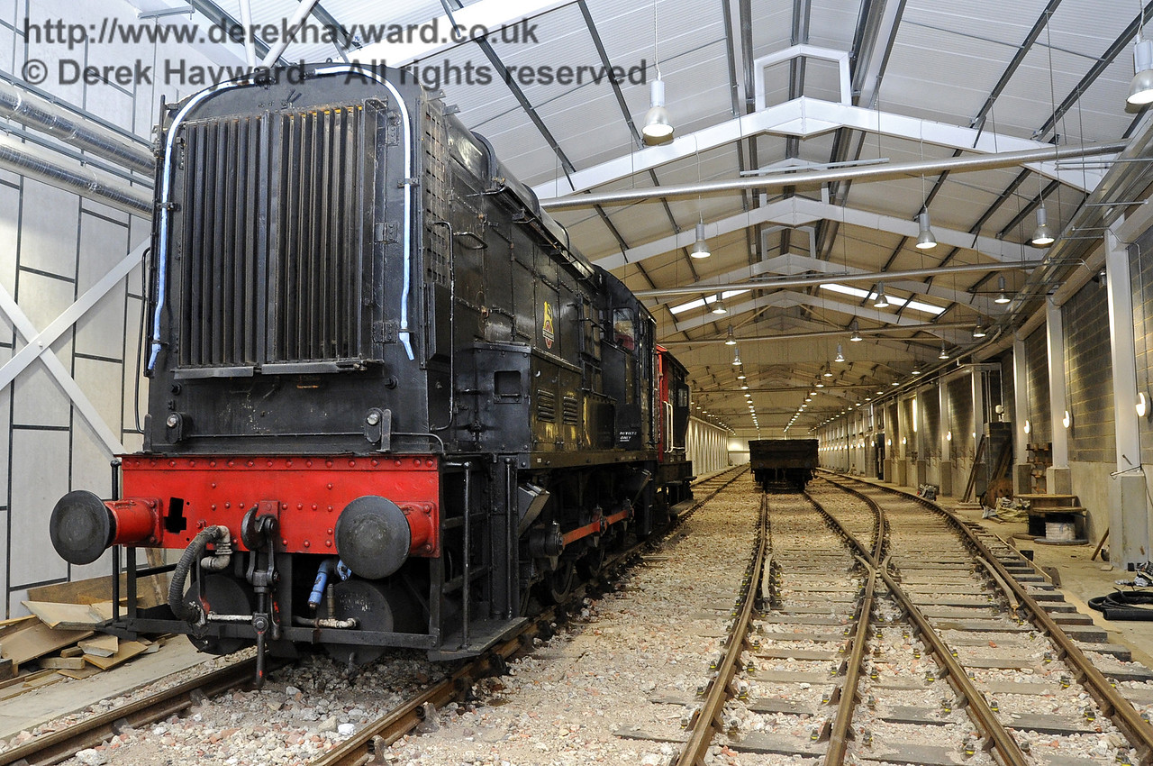 Looking north from the Carriage Shed entrance with the 08 diesel shunter at the head of a works train.  21.10.2011  3025