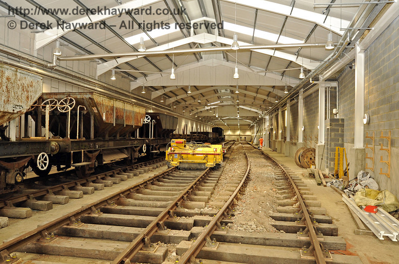 Looking north in the Carriage Shed with the new track in the foreground.  The first batch of fill material has been laid between the sleepers in C road.  13.08.2011  2470