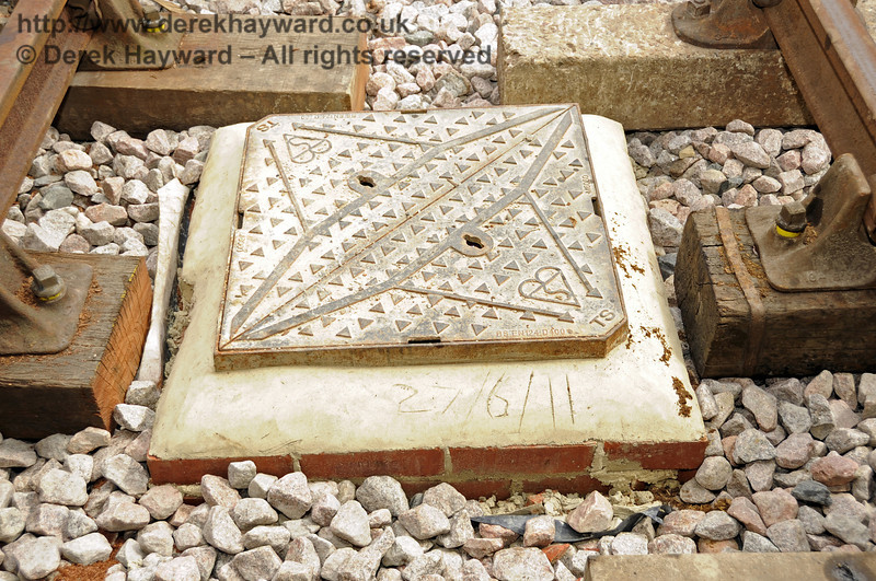 One of the many new manhole covers, which appears to have been suitably dated.  27.07.2011  2360
