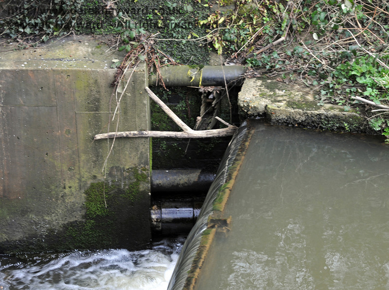 A close up of the point at which the river approaches the culvert which runs east under the railway.  09.03.2011  6134