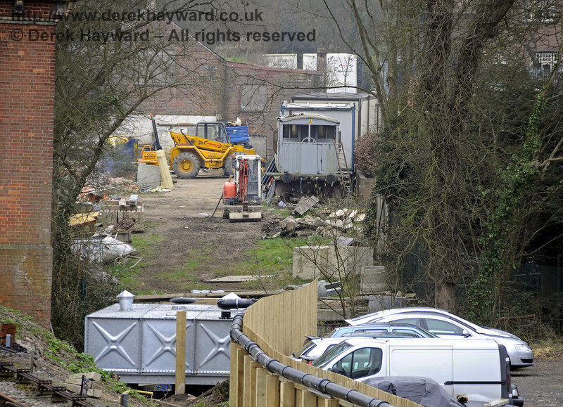 Looking south towards the new rain water tank, with a contractor's yard in the background.  17.03.2011  6474