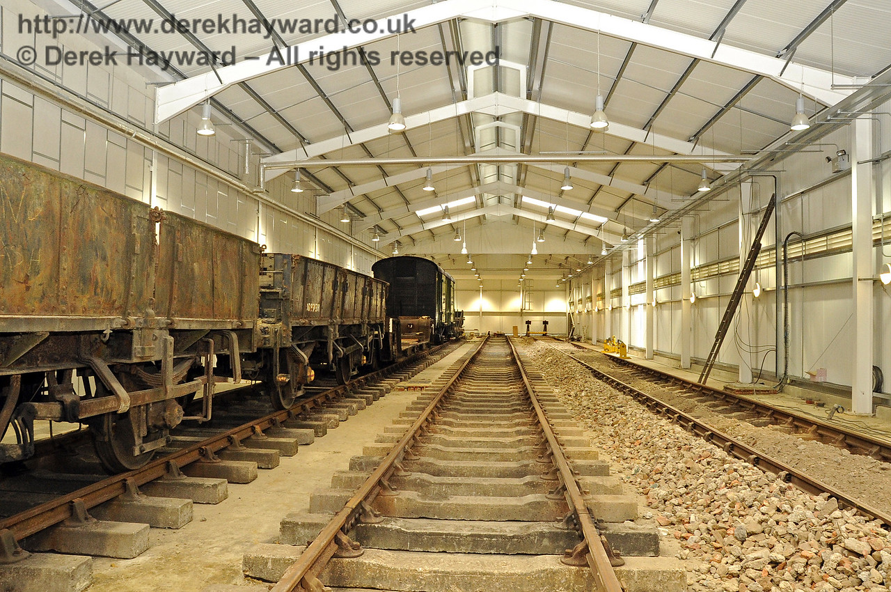 Looking north in the Carriage Shed with the new track now extending towards the buffers. The first batch of fill material has been laid between the sleepers in C road.   13.08.2011  2467