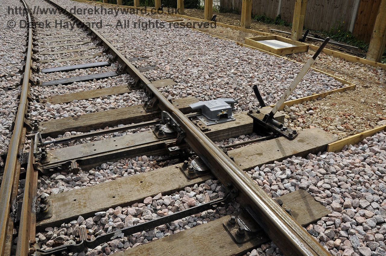 A close up of one of the sets of points outside the Carriage Shed with the rods and levers now in place. The base for a path has been laid.  29.08.2011  2771