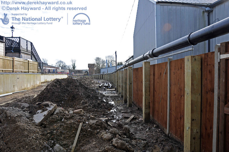 The rainwater harvesting pipes run south towards the water tower on top of the boundary fence. 24.02.2011  5929