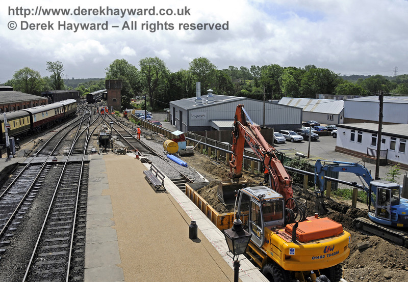 Removing excess spoil to allow the track to be laid into the Carriage Shed.  26.05.2011  7310