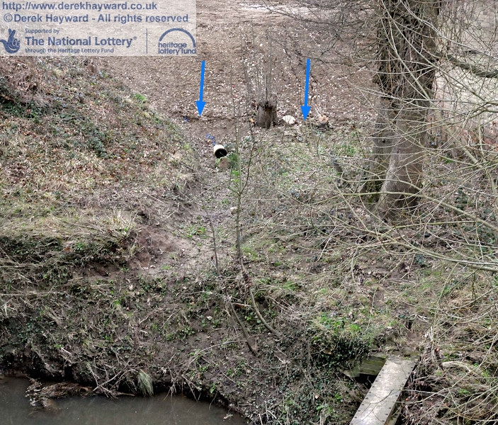 This shot of the outlet pipe is annotated with blue arrows to indicate the approximate point reached by the River Ouse during the recent flood. Contrast this point with the normal level of the river in the bottom left hand corner.  The river cannot normally rise further as excess water then drains through the (normally dry) Poleay Bridge to the north, which acts as an overflow. 06.02.2011  5835