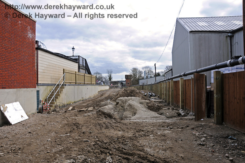 Looking south from the Carriage Shed entrance.  The new boundary fence is on the right, and the steps to Platform 2 on the left.  09.03.2011  6166