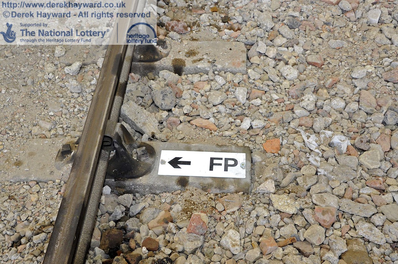 The Fouling Points have now been marked.  This is the point at which any stock south of the Fouling Point would foul access to the other tracks.  As the shed is a siding/yard, the FP is at the physical fouling point.  If it was a signalled move, it would be 16 feet further back.  24.11.2011  3172