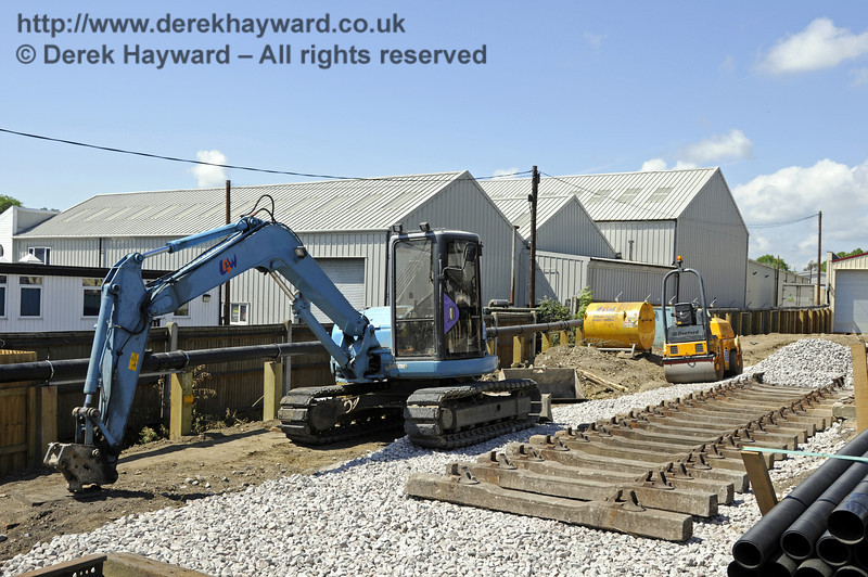Looking north towards the Carriage Shed, with newly laid sleepers and plant in shot.  21.05.2011  7134