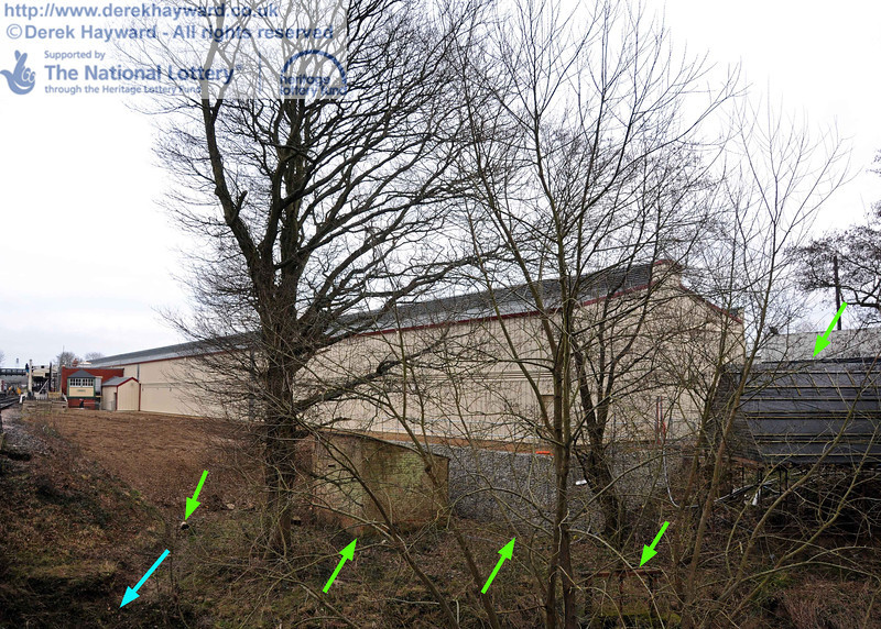This shot shows the northern end of the site before spring growth blocks the view. From right to left the green arrows indicate the temporary bat roost (to be dismantled in due course); the lifting barrier that admitted water from the River Ouse into the pipes feeding the old Pump House; the gabion wall protecting the carriage shed from the river; the original Pump House; and the outlet from the new drainage system. The blue arrow is the trench down to the River Ouse. 06.02.2011  5833