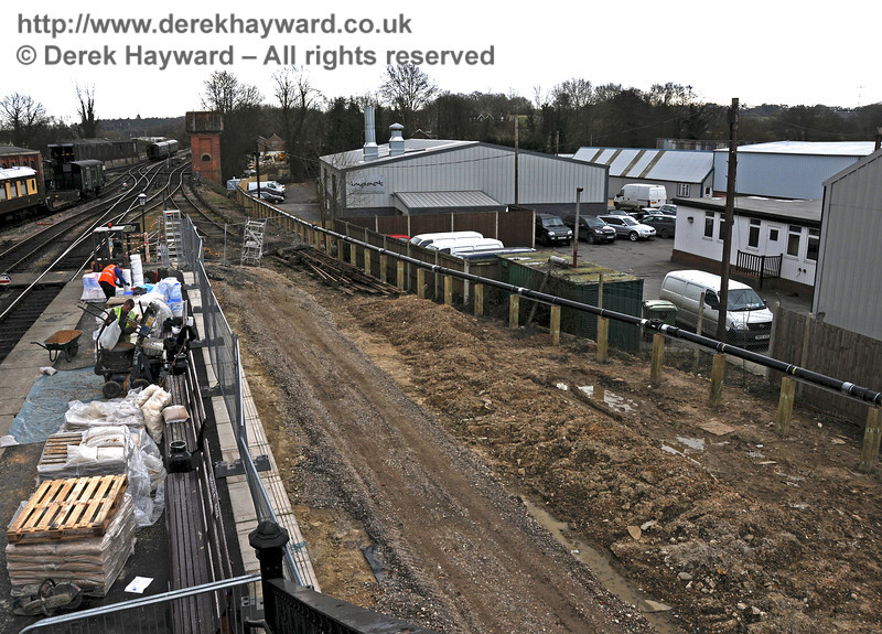 Looking south at the dock area from the footbridge.  Materials are stored on Platform 2.  09.03.2011  6116