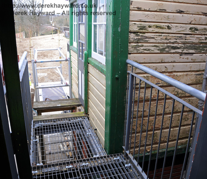 The metal walkway which will give access from the Museum to the Withyham signal box was being fitted.  09.03.2011  6091