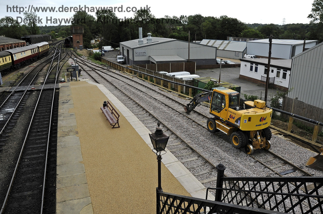 Looking south from the footbridge at Sheffield Park with the new track to the Carriage Shed and Dock in place.  13.08.2011  2462