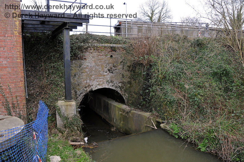 Adjacent to the water tower the river runs east under the track through a large culvert.  The watercourse subsequently turns north, runs adjacent to the car park, and flows into the River Ouse. 09.03.2011  6133  More pictures of the course of the river appear in the collection relating to the locomotive wash out pit.
